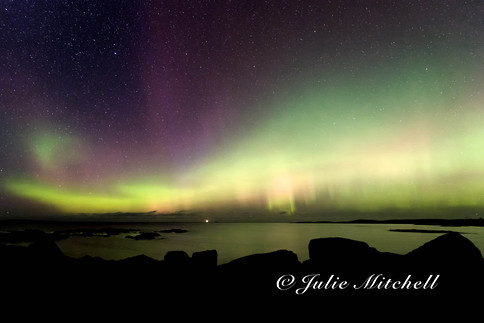 Northern lights over the sea in Scotland