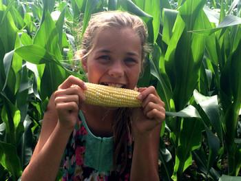 Mia Biting Peaches and Xtreme sweet corn