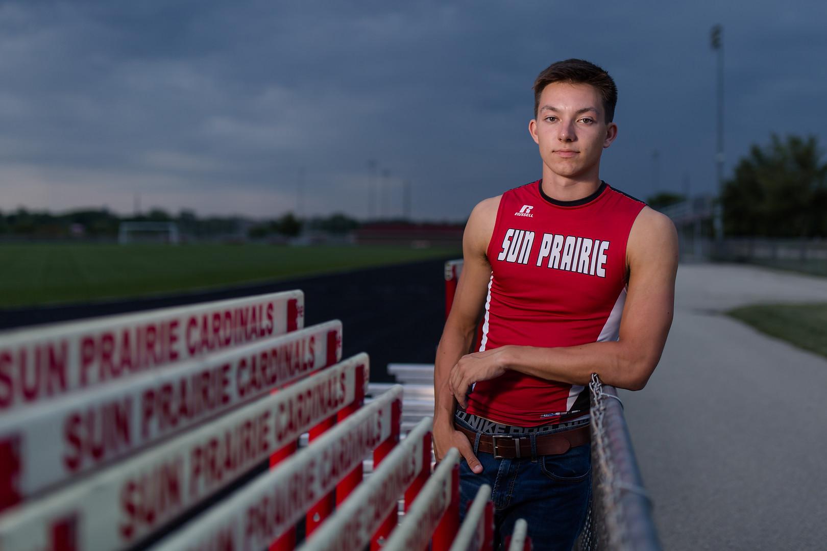 senior photo at sun prairie high school track