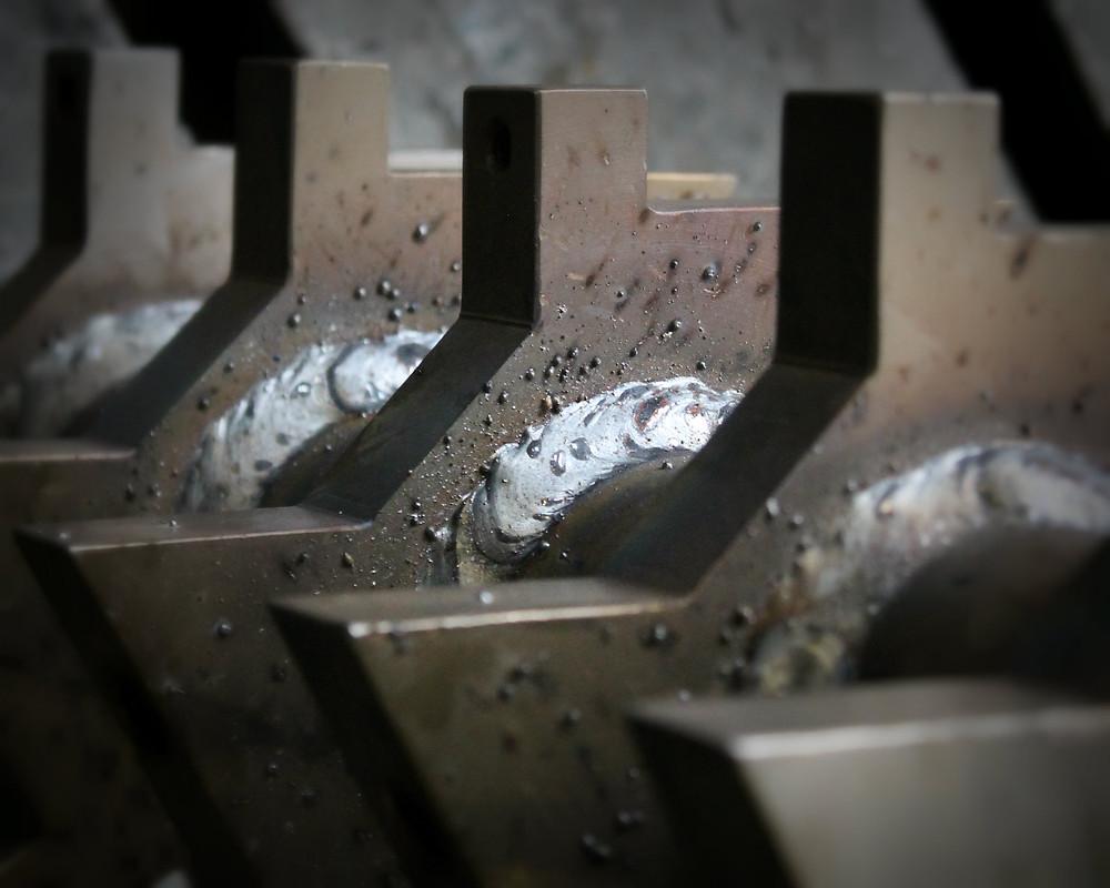 билы ротора дробилки приварены на вал