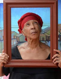 Awilda Sterling en su performance de Goyita, pintura del maestro Rafael Tufiño en La Campechada, 2013