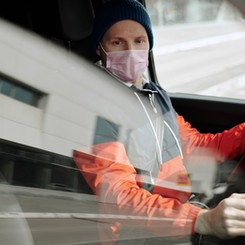 man-wearing-a-face-mask-driving-a-vehicl