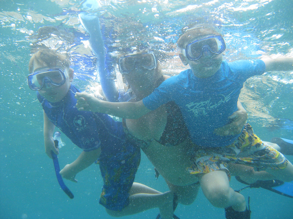 Childrens first snorkel experience