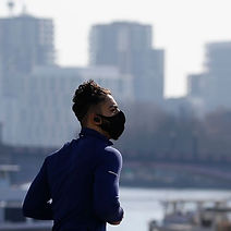 jogger-in-a-mask-runs-along-westminster-