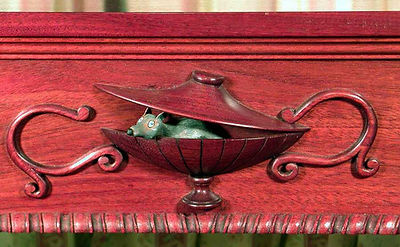 close-up of formal mahogany Chippendale table with mouse