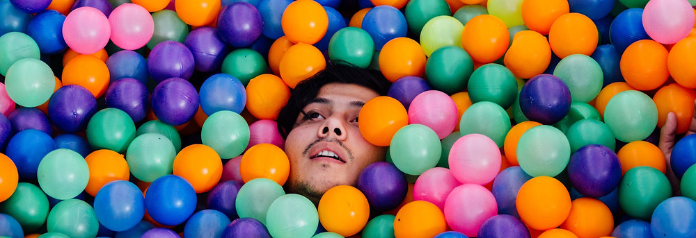 man in a ball pit