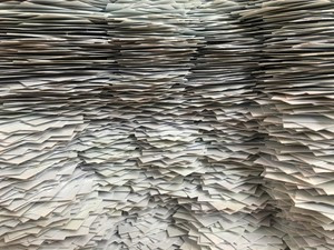 a large pile of papers