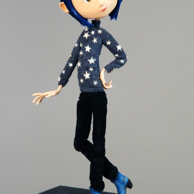 Coraline wearing star sweater