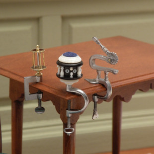 Thread winders, pin cushion and sewing clamp, 2011
