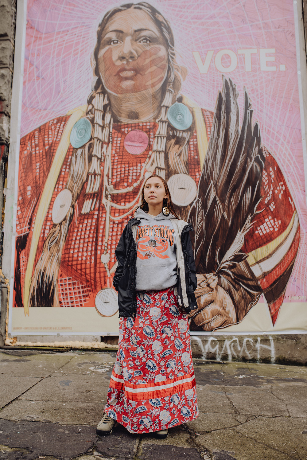 Mural painted by LMNOPI from photograph by Brandee Paisano.  Roxanne White mural is one mural a part of an Indigenous  People's Day project by Amplifier, Nia Tero, and IllumiNatives.