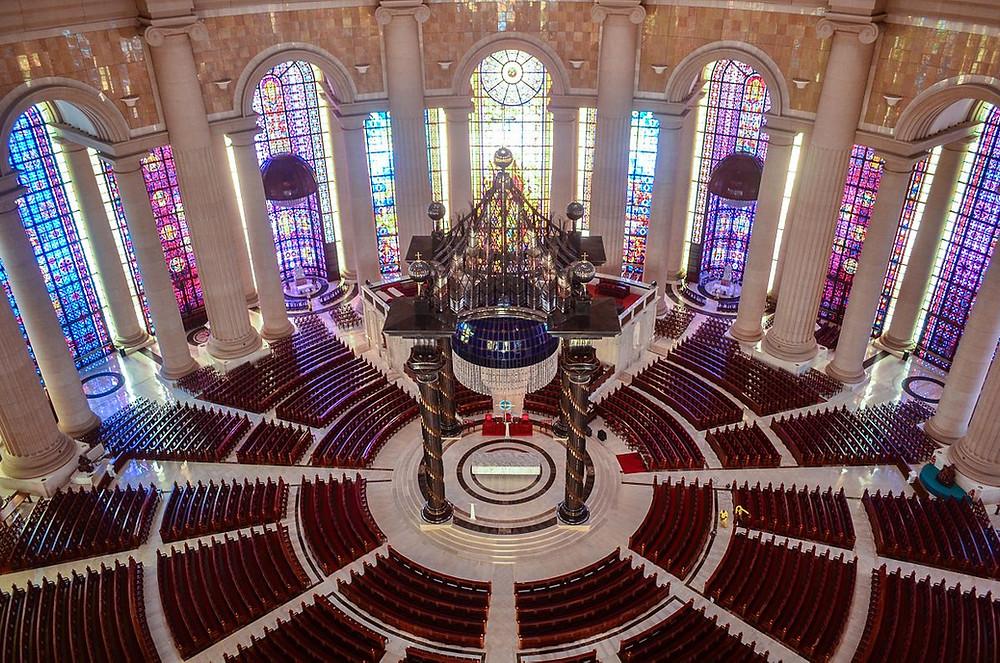 Ornate circular church with canopy over altar