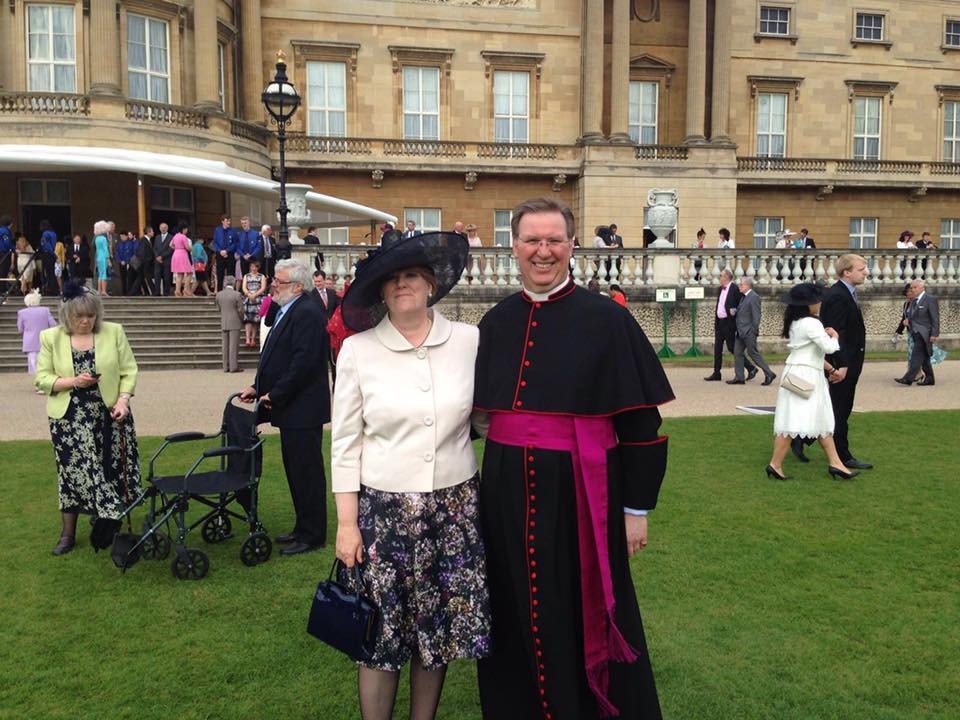 Fr Andrew and Helen at Buckingham Palace