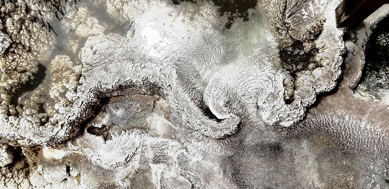 Black and white image of abstract patterns from a geiser at Yellowstone National Park