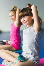 two-girls-doing-yoga-stretching-fitness-