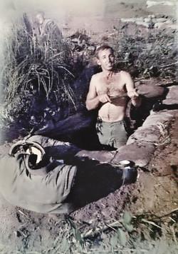 10.5 1967 Derl digging one of many fox holes.jpg
