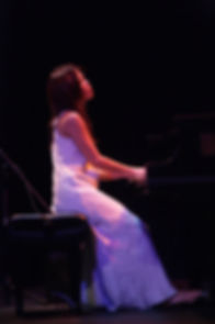 Motoko Honda playing piano, photo by Reto Halme