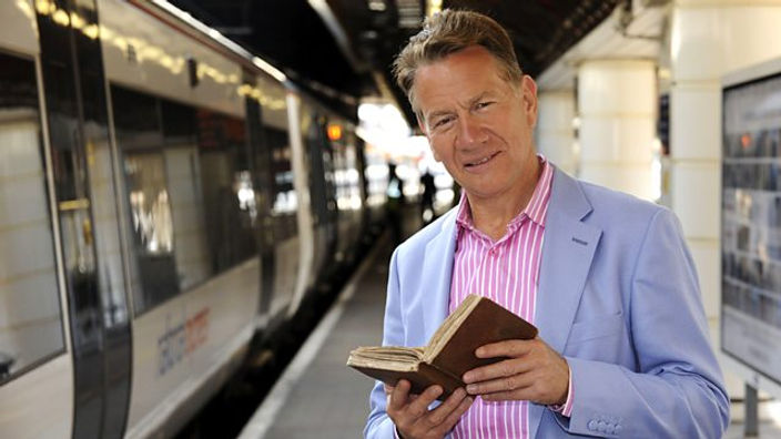 Michael Portillo standing next to a c2c train at Southend Central station