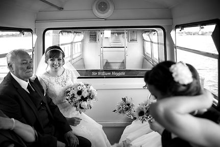Bride and father sitting on Southend Pier train