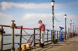 Man fishing off Southend Pier