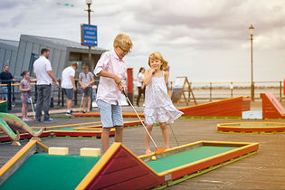 Children playing Crazy Golf on Southend Pier