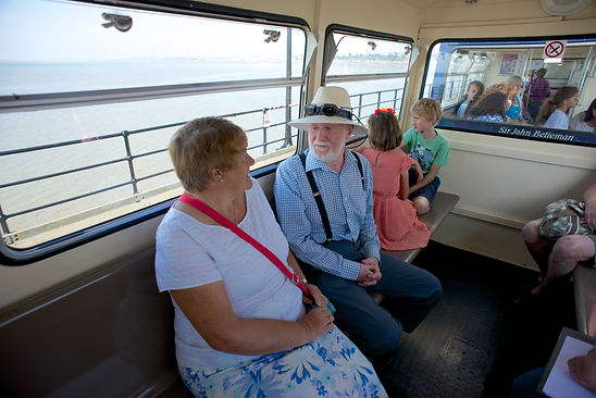 Older couple and children riding the Southend Pier Train