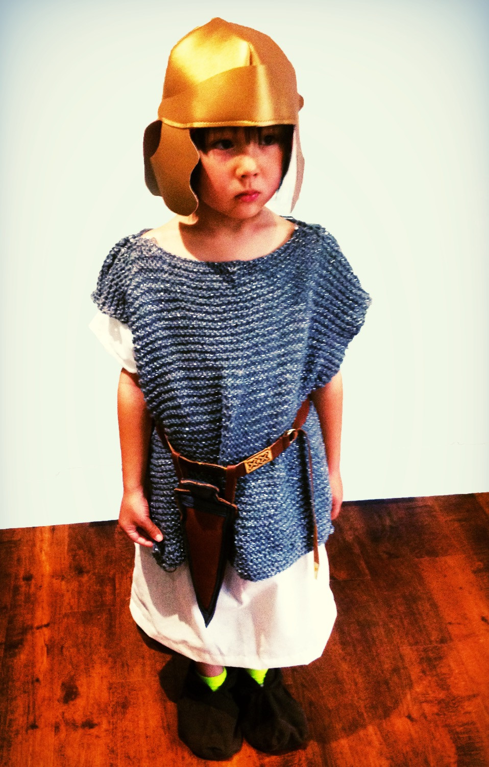 Small Roman soldier standing to attention.