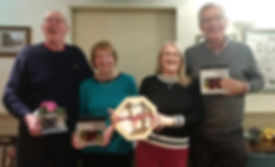 Quiz winners with their prizes