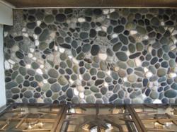 Pebble mosaic backsplash