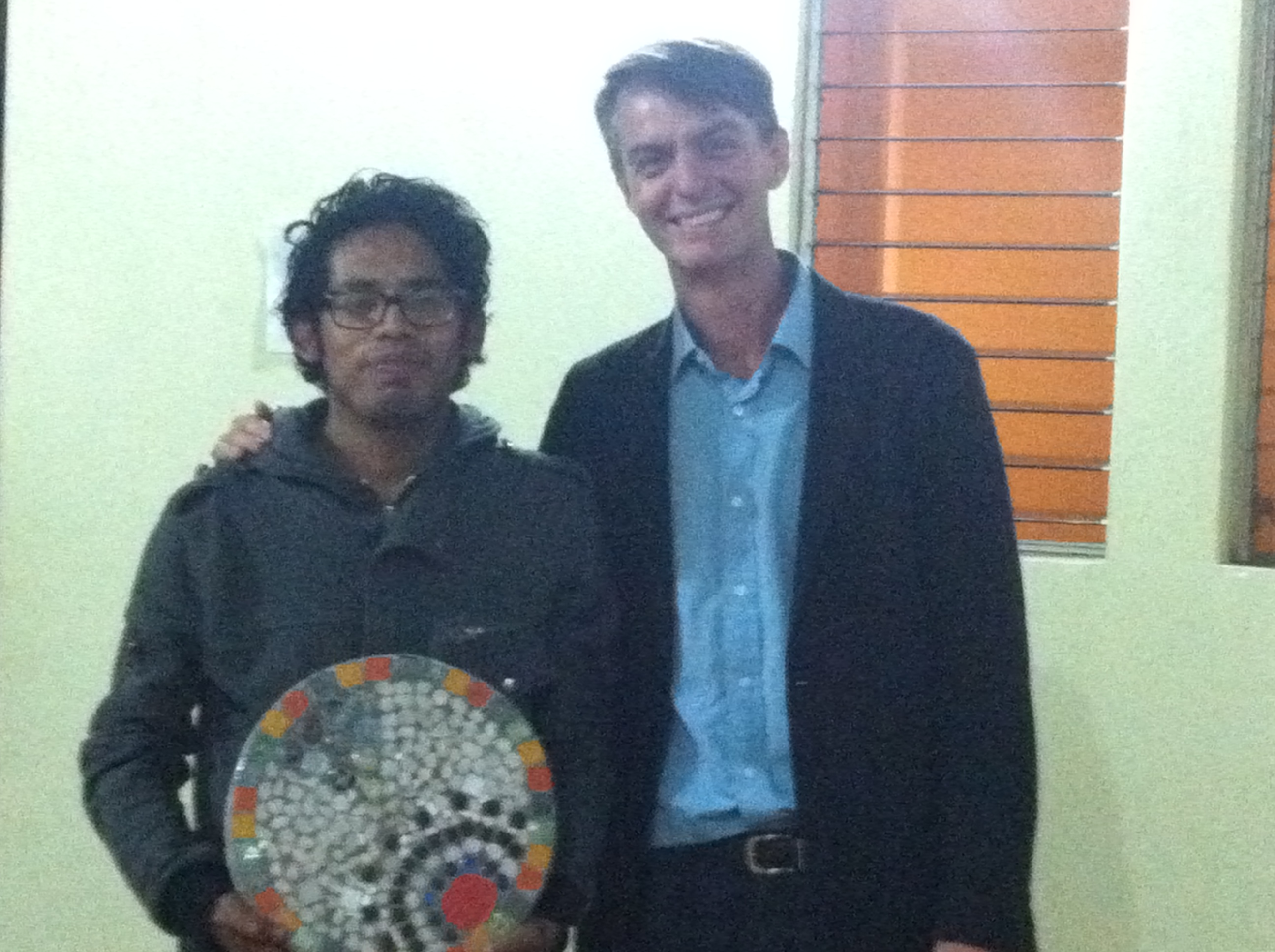 Student artist with mosaic