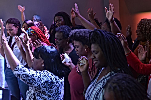 Altar call- hands lifted shot.JPG