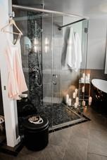 beautiful black tile shower Amanda George Interior Design