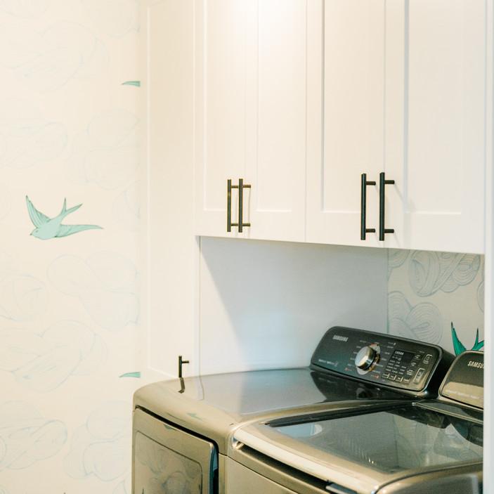 laundry room makover modern fresh Amanda George Interior Design bird wallpaper white cabinets
