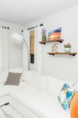 living space remodel white black modern Amanda George Interior Design shelving