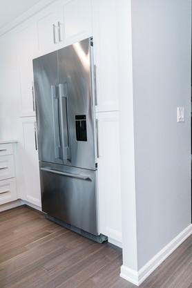 royal blue white modern kitchen remodel Amanda George Interior Design fridge modern