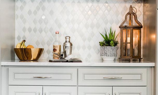 modern gold and grey tile white cabinets Amanda George Interior Design