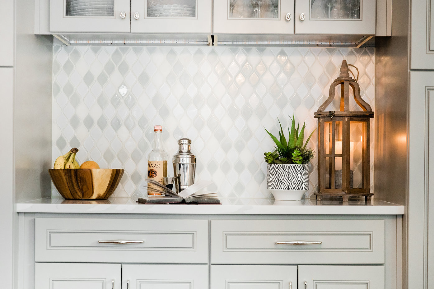 modern gold and white cabinetry Amanda George Interior Design
