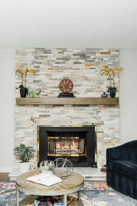 cozy modern living space grey tile fireplace Amanda George Interior Design