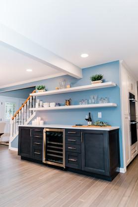 open concept blue and white shelf bar Amanda George Interior Design