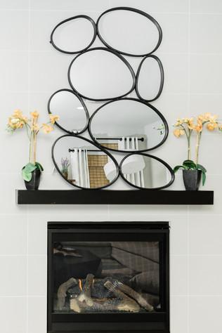 living space remodel white black modern Amanda George Interior Design mirror