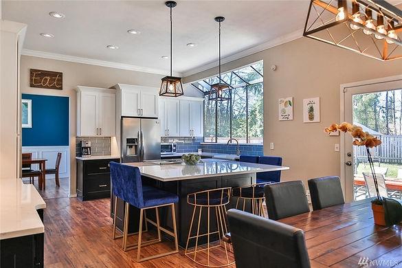 rich blue and modern wood kitchen Amanda George Interior Design