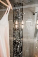 shower closeup black stone tile Amanda George Interior Design