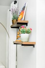 living space remodel white black modern Amanda George Interior Design detail shelving