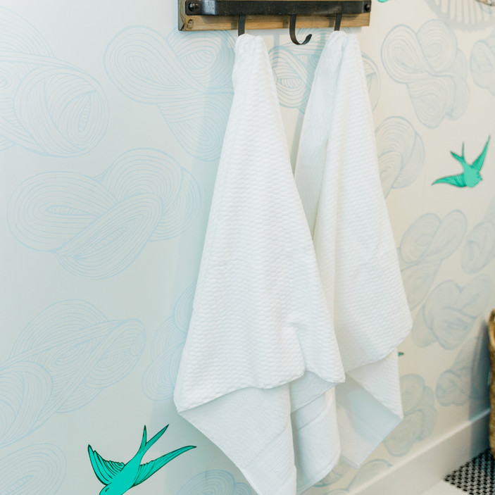 laundry room makover modern fresh Amanda George Interior Design bird wallpaper custom hooks