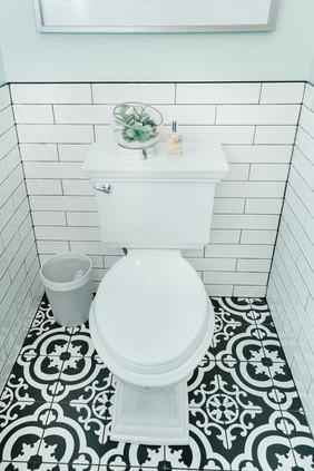 mint bathroom white tile details Amanda George Interior Design black and white tile floor