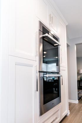 royal blue white modern kitchen remodel Amanda George Interior Design double ovens