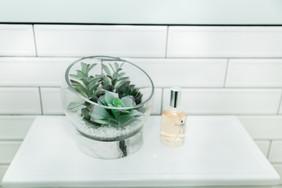 mint bathroom white tile details Amanda George Interior Design