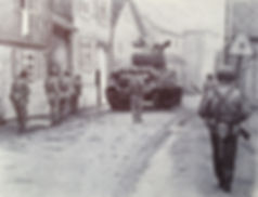 Ballpoint pen drawing of US Army soldiers advancing through a town in Europe
