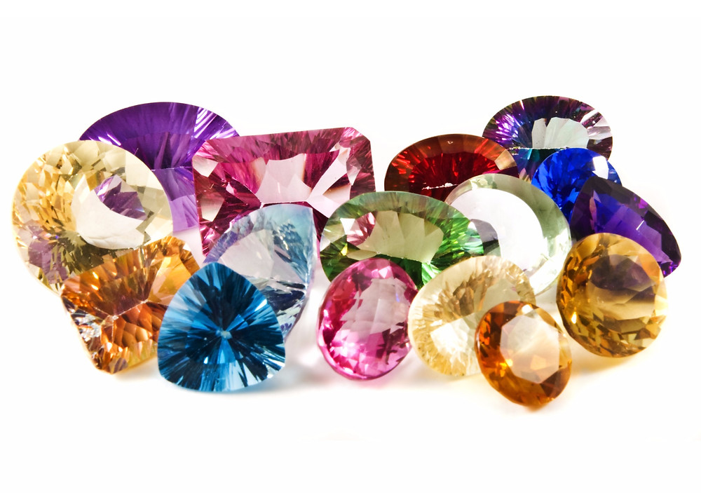 Different coloured and shaped gemstones representing different birthstones