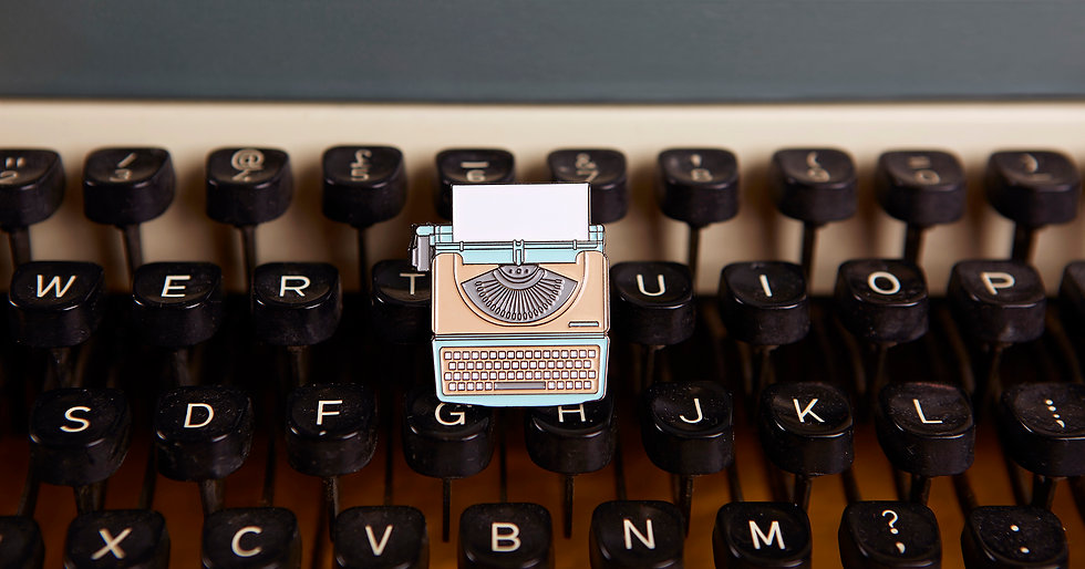 typewriter_badge_web.jpg