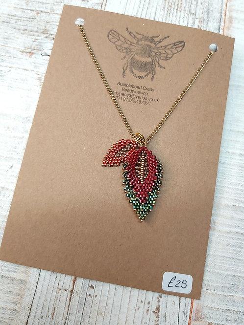 Handmade beaded layered leaf pendant